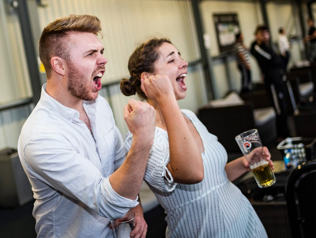 Man and woman celebrating golf results